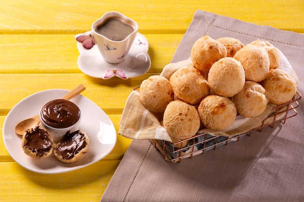 Brazilian snack cheese bread stuffed with chocolate. Premium Photo