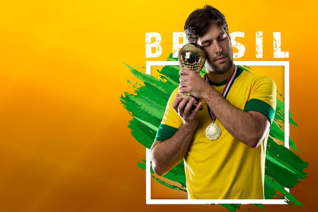 Brazilian soccer player, celebrating the champion victory Free Photo