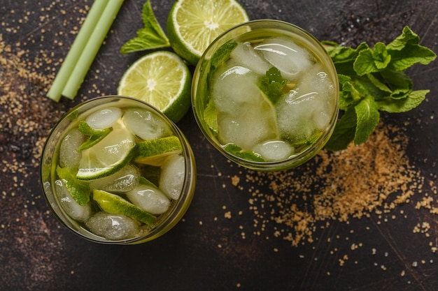 Brazilian traditional caipirinha with lime, sugar and mint. dark background, top view,  copy space. Premium Photo
