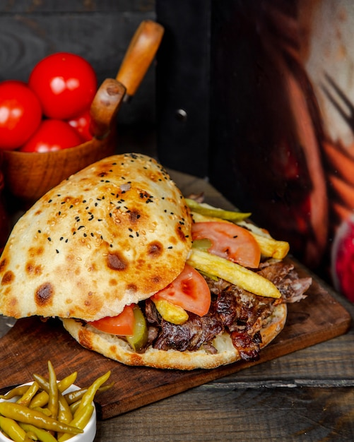 Bread pita meat doner on wooden board Free Photo