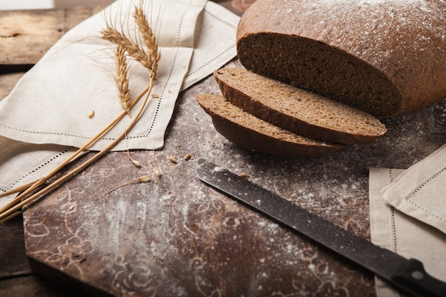Bread rye spikelets on an wooden background Free Photo