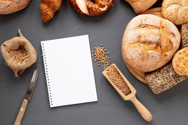 Bread seeds and blank notebook Free Photo