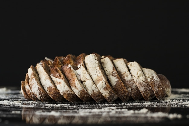 Bread slices against black background Free Photo