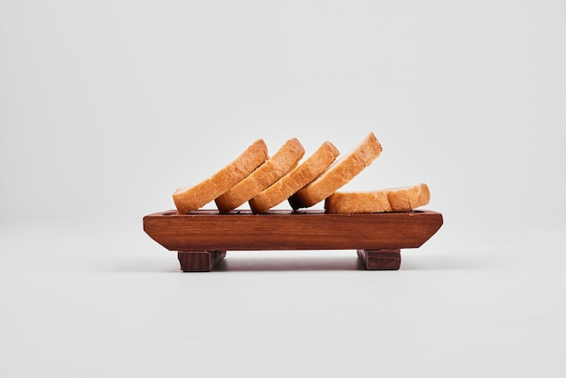 Bread slices on wooden board. Free Photo
