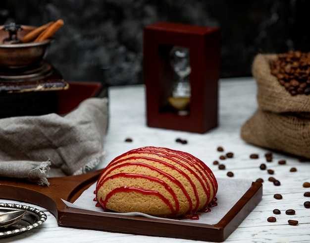 Bread topped with jam on desk Free Photo