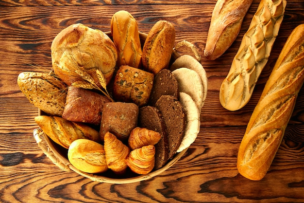 Bread varied mix on golden aged wood table Premium Photo