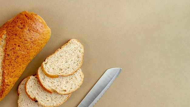 Bread with knife top view Free Photo