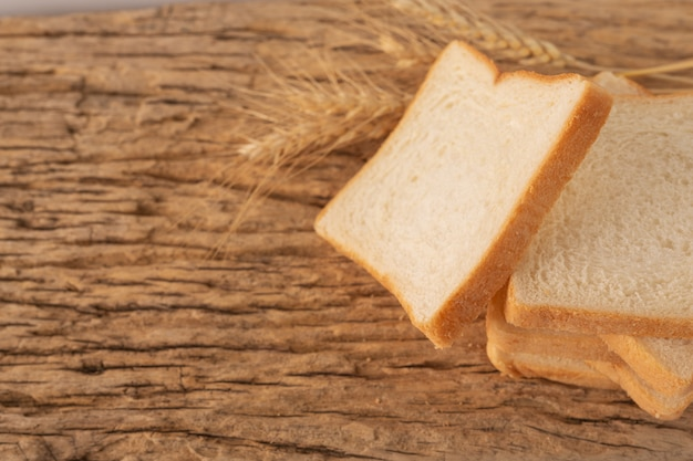 Bread on a wooden table on an old wooden floor. Free Photo