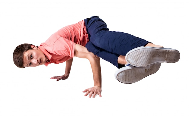 Break dancer doing handstand against  white background Free Photo