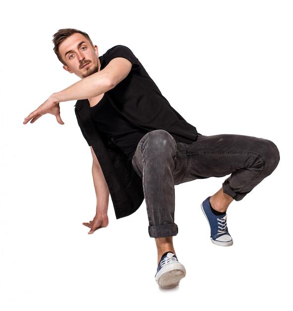 Брейк танцор делает одной рукой стойку на белом фоне Бесплатные Фотографии
