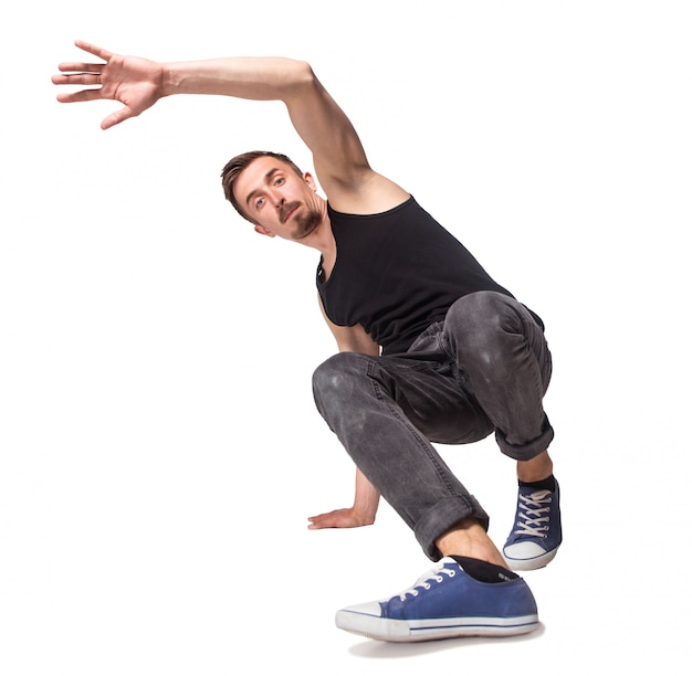 Перерыв танцовщица делает одной рукой стойку на белом фоне Бесплатные Фотографии