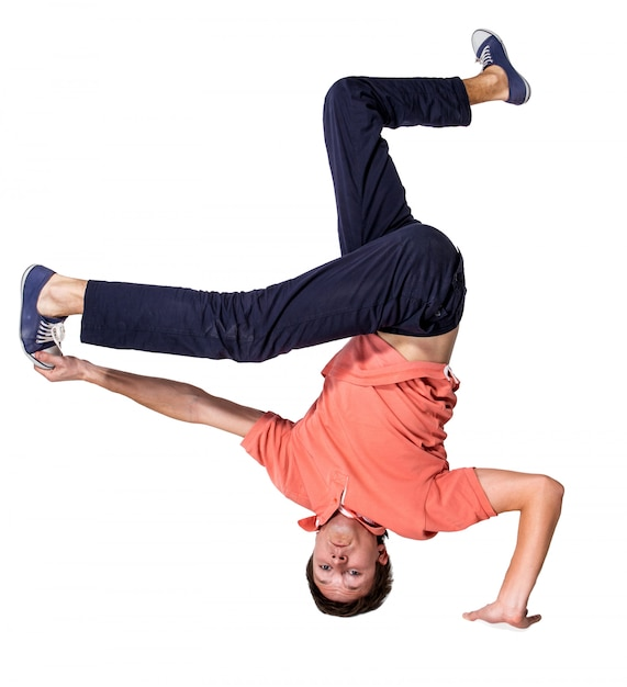 Break dancer doing one handed handstand against a white background Free Photo