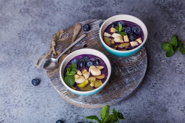 Breakfast acai smoothie bowl for healthy lifestyle Premium Photo