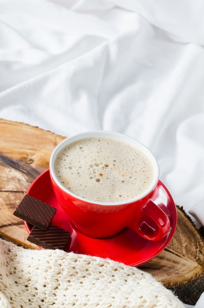 Breakfast in bed. cappuccino and chocolate. Premium Photo