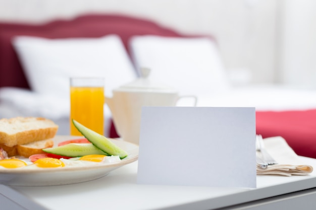Breakfast in bed in hotel room Premium Photo
