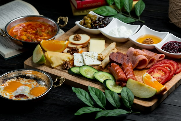 Breakfast platter with mixed combination of foods Free Photo