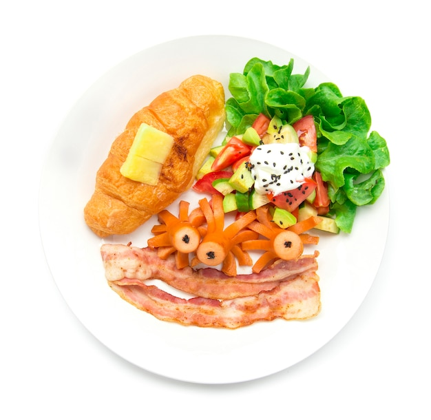 Breakfast set with croissant and sausage pork, bacon  and avocado salad mix  vegetable on top greek yogurt sprinkle black sasemi and leaf green oak food for daily morning top view Premium Photo