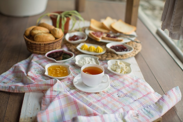 Breakfast set with tea on the table Free Photo