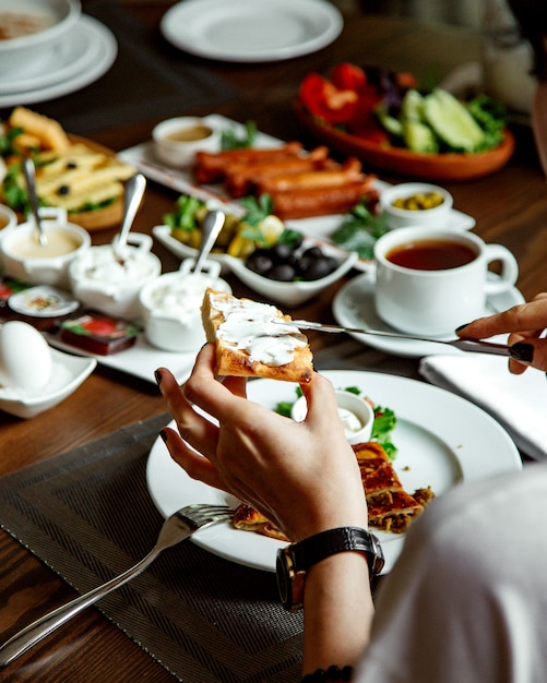 Breakfast set with various food on the table Free Photo