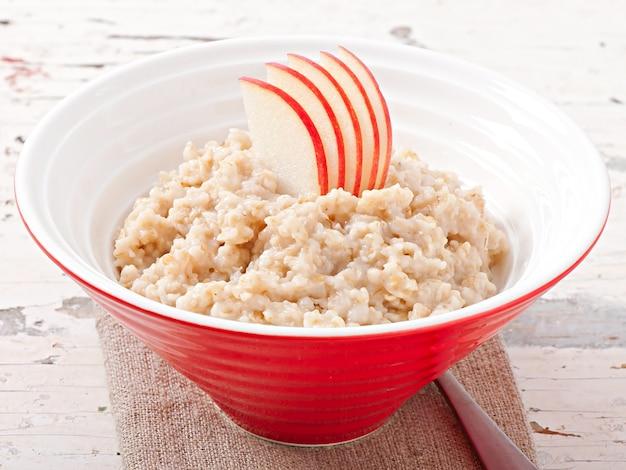 Breakfast - useful oatmeal with apples Premium Photo