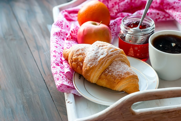 Breakfast with coffee and croissant Premium Photo