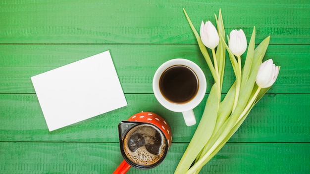 Breakfast with coffee cup and flowers Free Photo