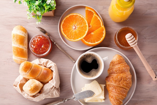 Breakfast with coffee, orange juice and croissant. top view Premium Photo
