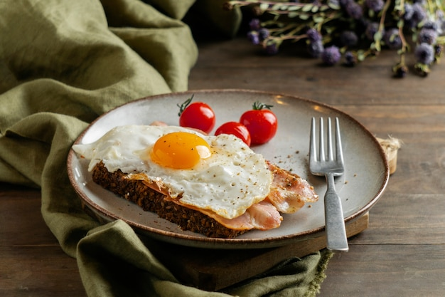 Breakfast with egg, bacon and tomatoes high angle Free Photo