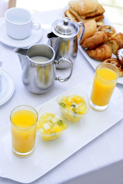 Breakfast with orange juice coffe tea milk Premium Photo