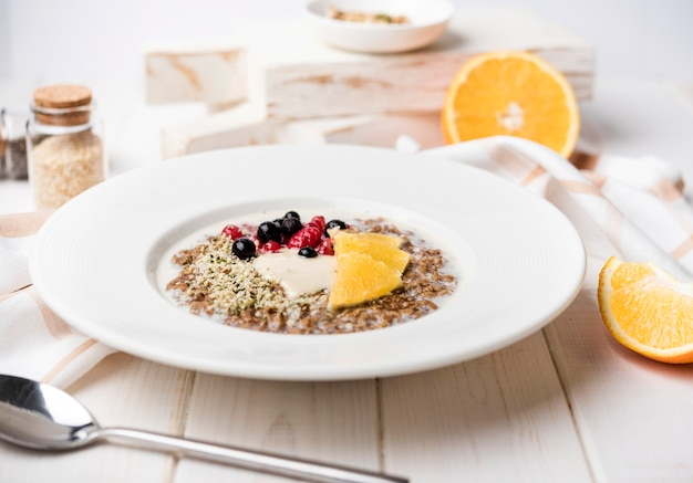 Breakfast with orange slices and seeds front view Free Photo