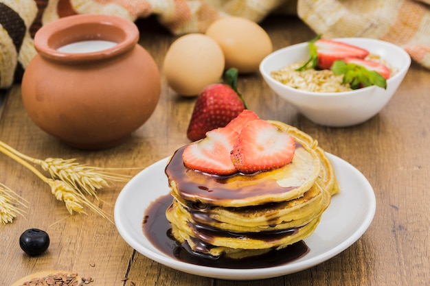 Breakfast with pancakes and strawberries Free Photo