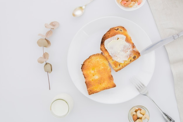 Breakfast with slices of bread and butter Free Photo