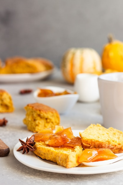Breakfast with spicy pumpkin scones, a cup of tea and milk. Premium Photo