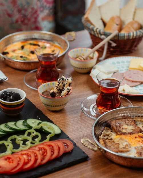 Breakfast with various food and black tea Free Photo
