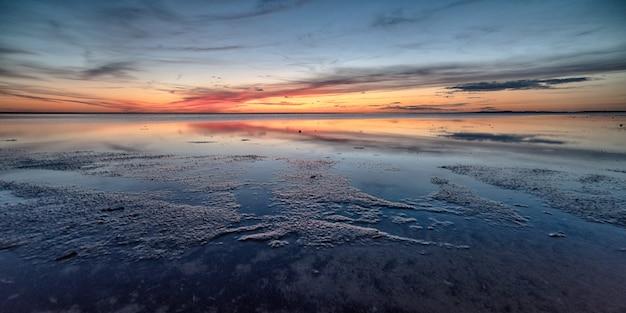 Breathtaking shot of a beautiful beach on a wonderful sunset Free Photo