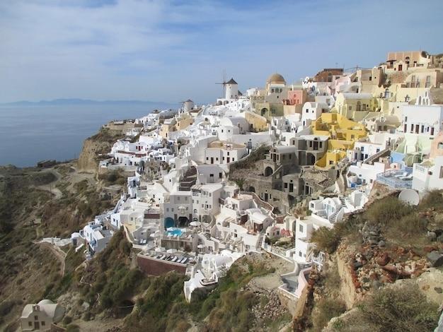 Breathtaking view of oia village landscape over the caldera, santorini island of greece Premium Photo