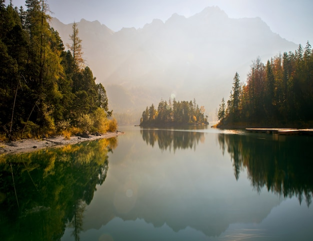 Breathtaking view of zugspitze lake surrounded with forests in eibsee Free Photo