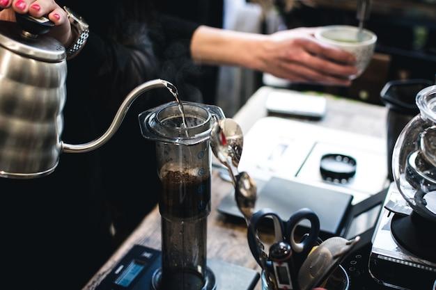 Brewing coffee in aeropress Free Photo