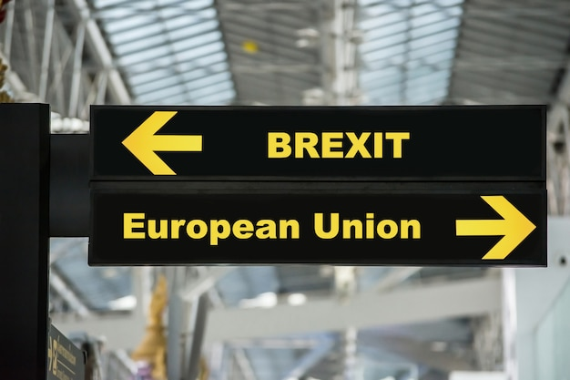 Brexit or british exit on airport sign board with blurred background. brexit concept. Premium Photo
