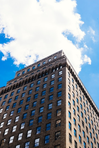 Brick high rise building angle from below cityscape Free Photo