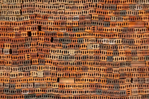 Brick piles placed on the factory floor. Free Photo