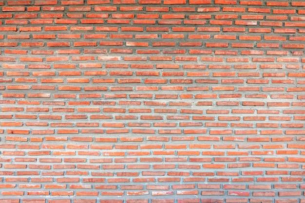 レンガの赤い壁。古いれんが造りの家の背景。 Premium写真