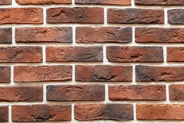 Brick stone wall made with blocks. pattern of slate wall texture and background Premium Photo