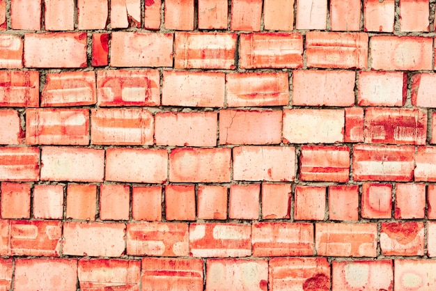 Brick texture with scratches and cracks background Premium Photo