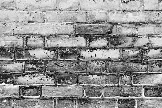 Brick texture with scratches and cracks Premium Photo