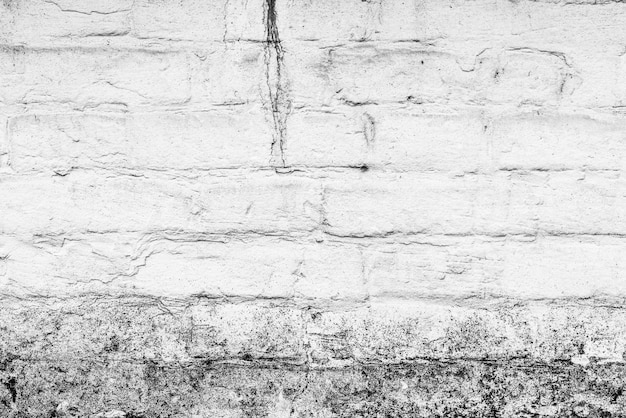 Brick texture with scratches and cracks Premium Photo