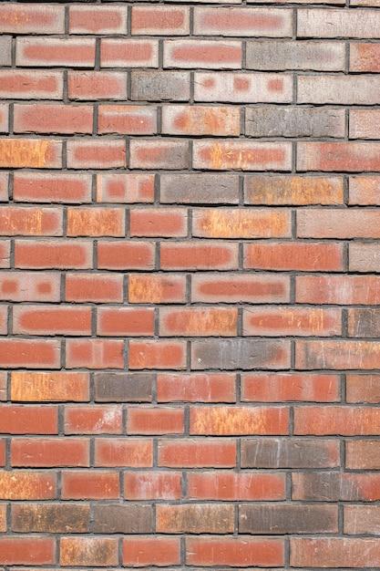 Кирпичная стена из натурального кирпича Premium Фотографии