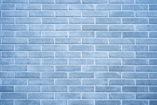 Brick wall. texture of gray brick with white filling Free Photo