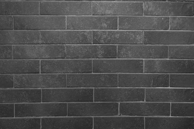 れんが壁。灰色の詰物と灰色のレンガのテクスチャ 無料写真