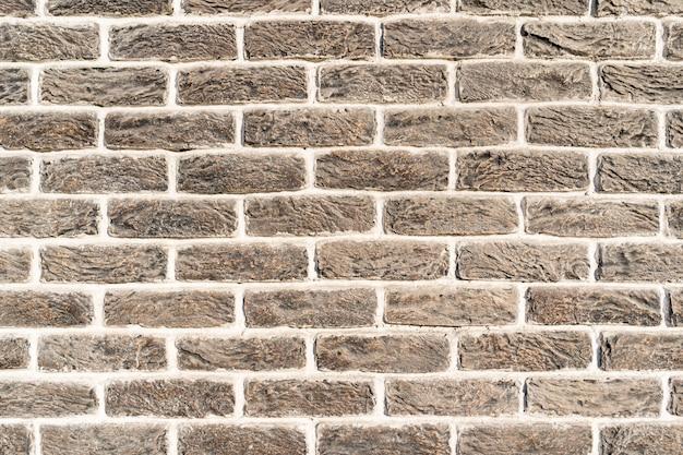 れんが壁。白い詰物が付いている灰色のクリームレンガのテクスチャ 無料写真